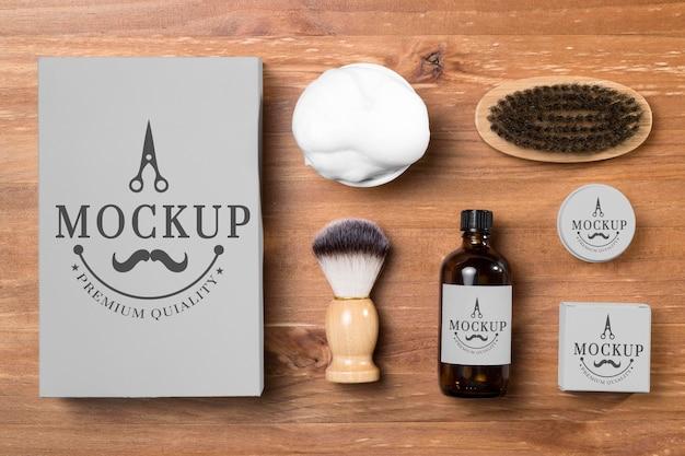 Visão plana do conjunto de produtos para cuidados da barba com espuma de barbear