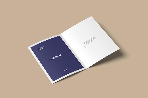 Vista de alto ângulo de maquete de brochura / folheto a4 dobrável
