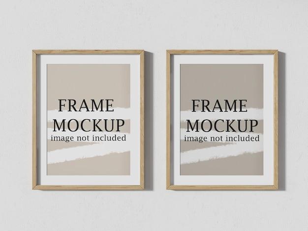Vista de perto duas maquetes de quadros de parede para fotos