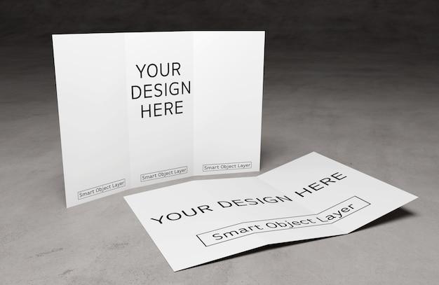 Vista de um folheto dobrável em três partes na maquete da tabela do cimento