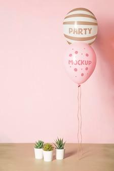 Vista frontal da maquete de balões para a festa