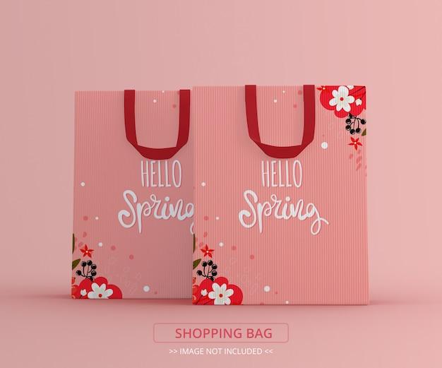 Vista frontal de maquete de duas sacolas de compras