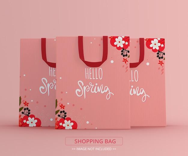 Vista frontal de maquete de três sacolas de compras