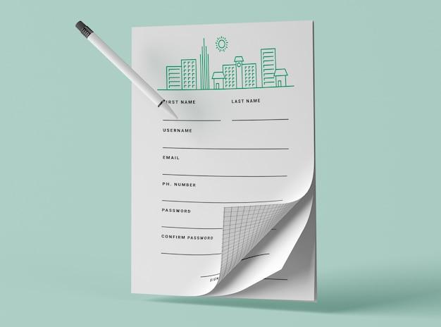 Vista frontal de papéis de maquete com caneta