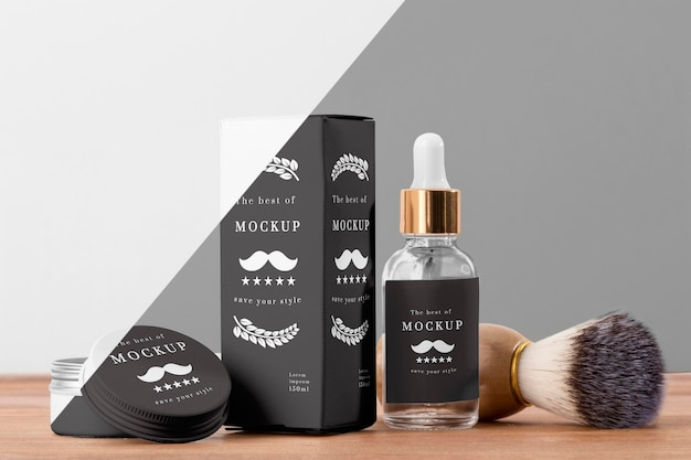 Vista frontal de produtos de barbearia com soro e escova