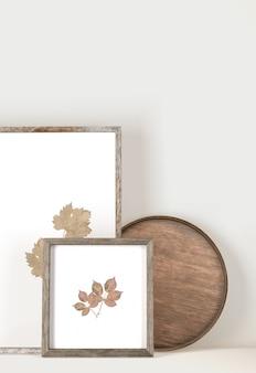 Vista frontal de quadros com folhas e bandeja de madeira