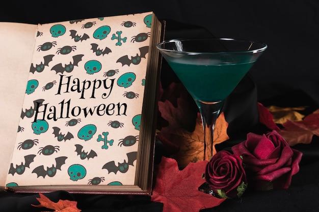 Vista frontal de um livro e copo com folhas
