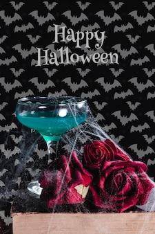Vista frontal do conceito de halloween com flores e livros