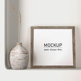 Vista frontal mock-up frame com decoração de vaso
