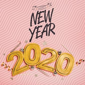Vista superior ano novo letras minimalistas em fundo rosa