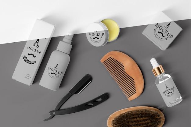 Vista superior da caixa de produtos de barbearia com soro, lâmina e pincel