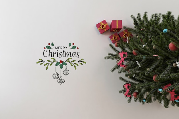 Vista superior da maquete de banner de feliz natal com árvore de natal e presentes