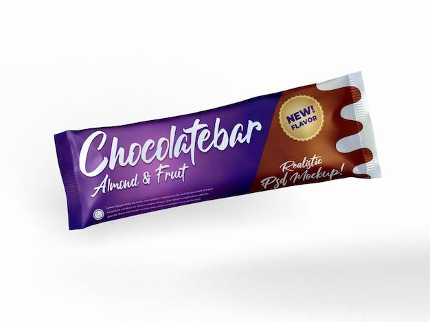 Vista superior da maquete de embalagem realista com barra de chocolate voadora lanche brilhante