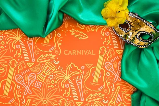 Vista superior da máscara e tecido de carnaval