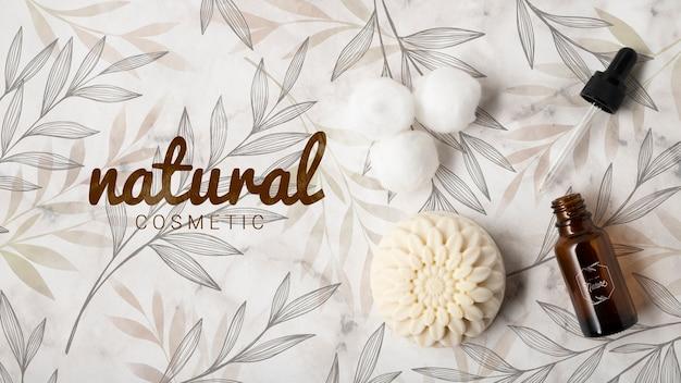 Vista superior de cosméticos naturais com óleo essencial e sabão