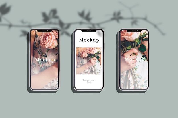 Vista superior de três smartphones com fotos e sombra