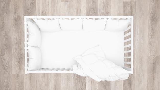 Vista superior do berço branco, piso de madeira parquet