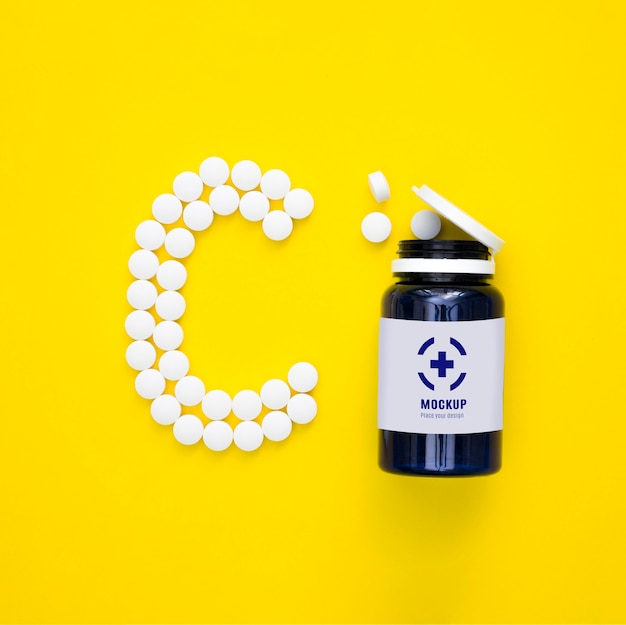 Vista superior do frasco com comprimidos em forma de c