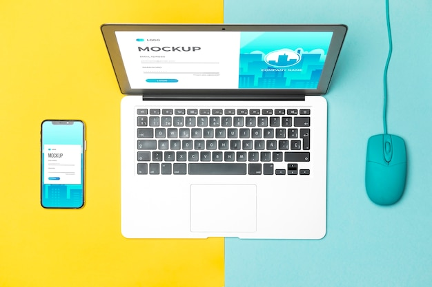 Vista superior do laptop, mouse e smartphone