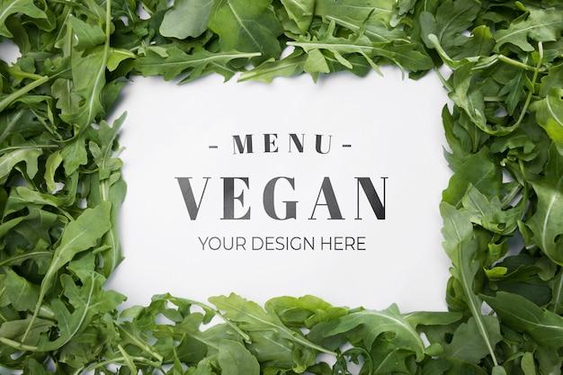 Vista superior do menu vegan com salada de rúcula
