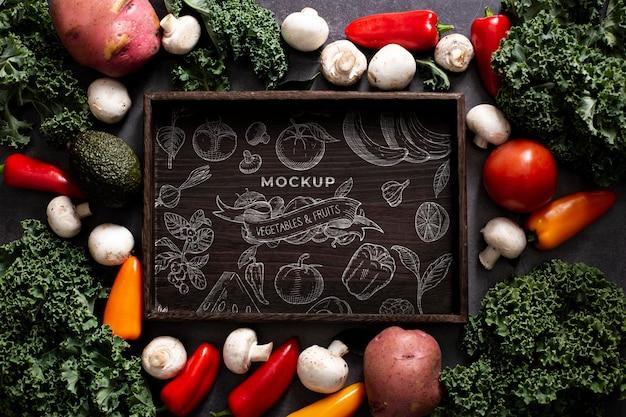 Vista superior do mock-up do conceito de vegetais saudáveis Psd grátis