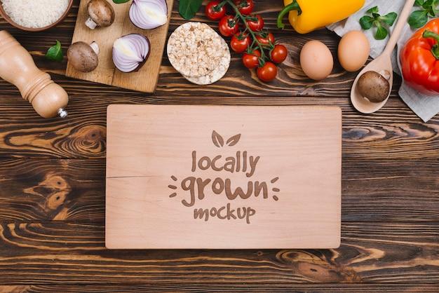 Vista superior maquete de comida vegana de legumes