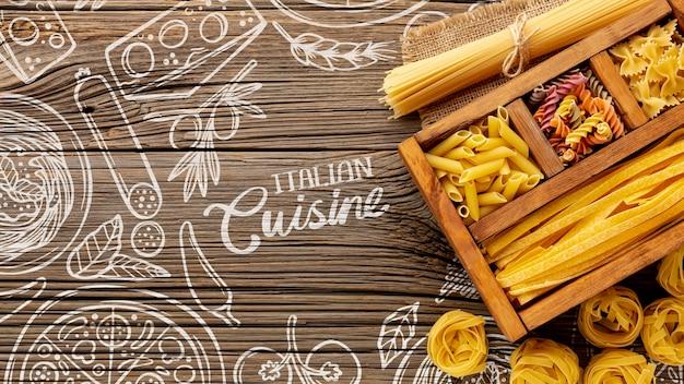 Vista superior variedade de massas alimentícias não cozidas em caixa de madeira na mão desenhada fundo
