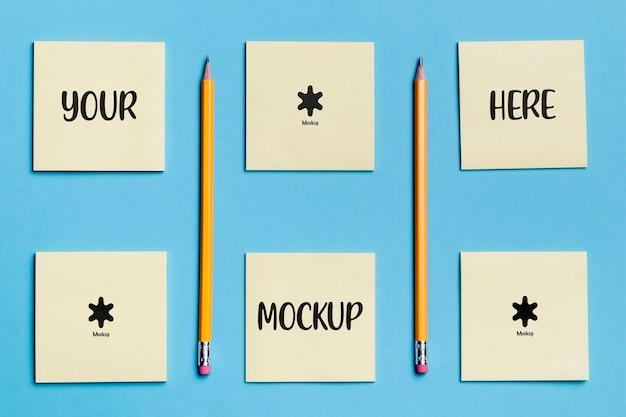 Vista superior variedade de notas e lápis