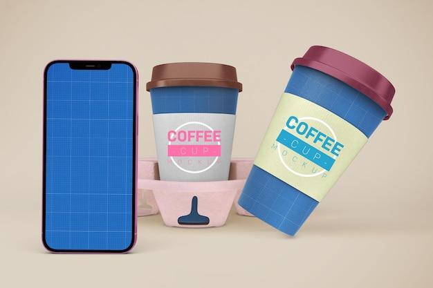 Xícaras de café e maquete de smartphone