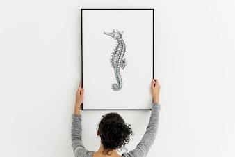 Cornice per foto con un'immagine disegnata cavalluccio marino