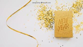Goldenes Buchmodell mit Weihnachtsdesign
