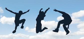Springen Menschen Silhouetten