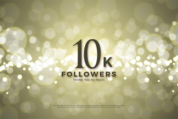 10k abonnés ou abonnés avec des chiffres noirs sur un fond d'or de luxe.