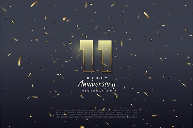 11e anniversaire avec des chiffres soulignés de brun doré.