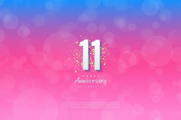 11e anniversaire avec illustration d'arrière-plan graduée du bleu au rose.