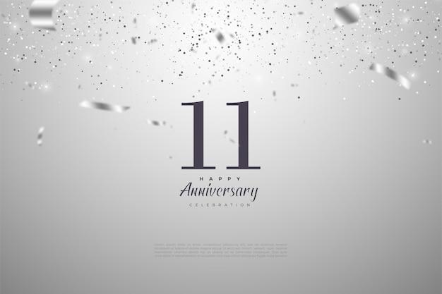 11e anniversaire avec illustration de numéros recouvert de rubans d'argent.