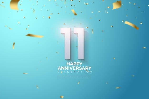 11e anniversaire avec un numéro lumineux et des confettis dorés