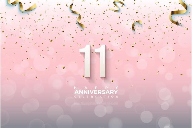 11e Anniversaire Avec Des Numéros D'or En Baisse Et Une Illustration De Ruban. Vecteur Premium