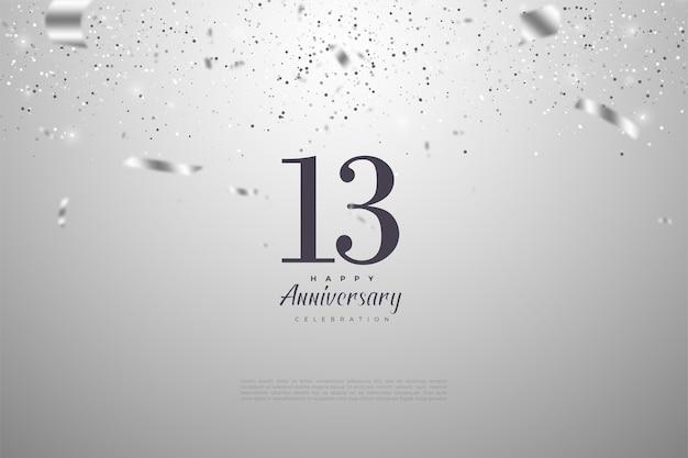 13e anniversaire avec ruban argenté et illustration des nombres.