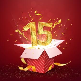 15 e anniversaire et coffret cadeau ouvert avec des confettis d'explosions.