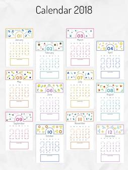 2018 année, calendrier mural et organisateur avec des motifs géométriques colorés.