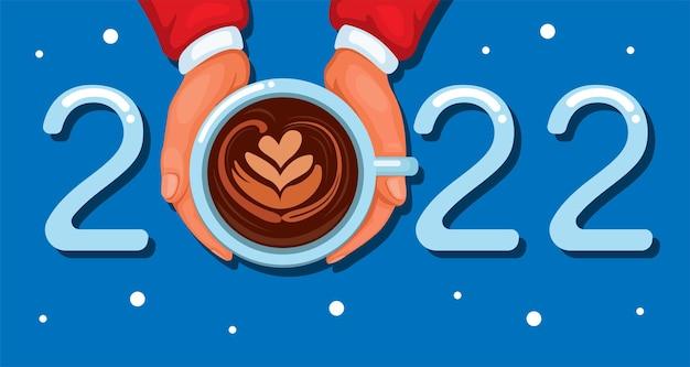 2022 bonne année et célébration de voeux de noël avec la main du père noël tenant le vecteur de dessin animé de café