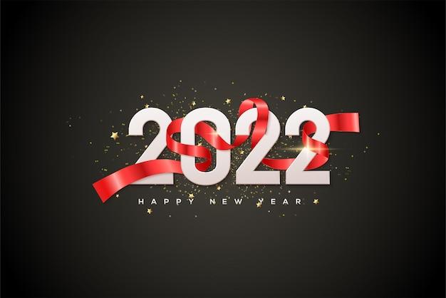 2022 bonne année avec des chiffres blancs fantaisie et un ruban rouge