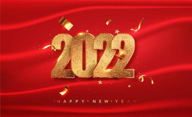 2022 bonne année avec des chiffres dorés et des paillettes