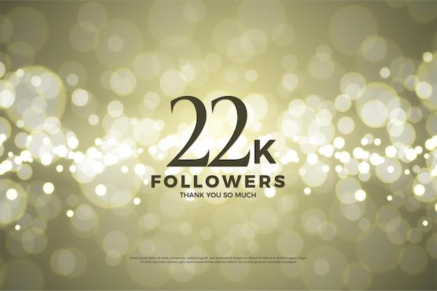 22k followers avec feuille d'or et effet bokeh