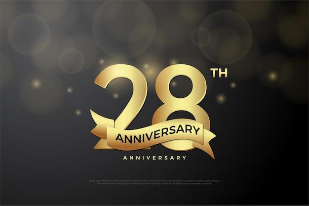 28e anniversaire fond avec des chiffres et des rubans d'or