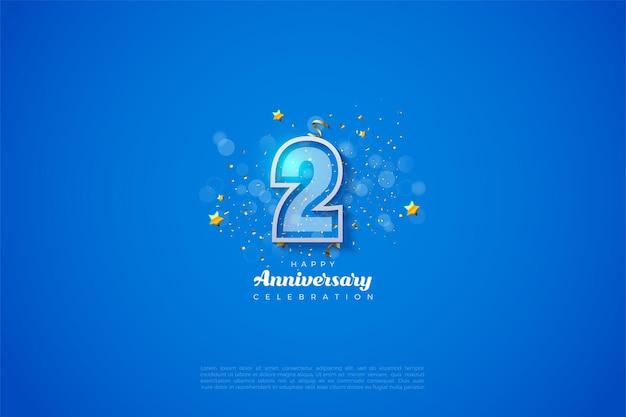 2e anniversaire avec des chiffres blancs sur fond bleu.