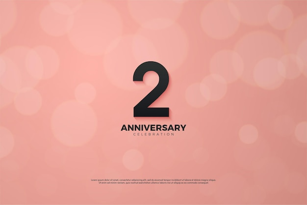 2e anniversaire avec illustration numéro noir sur fond rose avec effet bokeh.