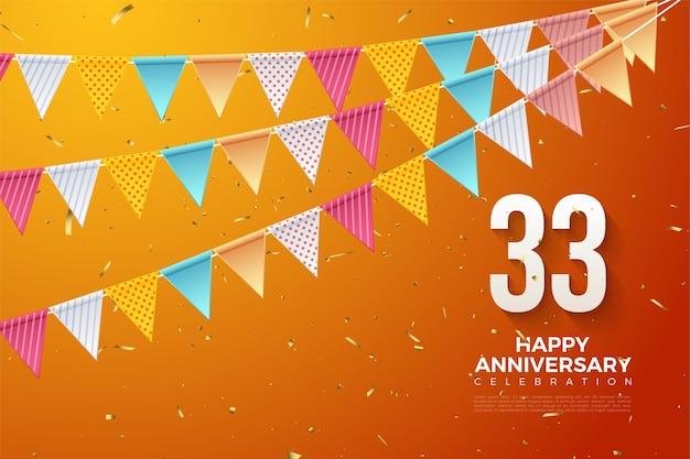 33e anniversaire avec des chiffres sous des drapeaux colorés