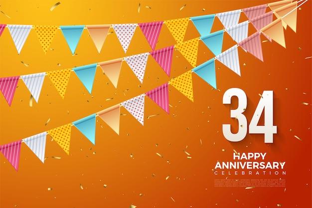 34e anniversaire avec chiffres et drapeau sur fond orange